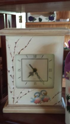 This clock is my design with the cutest little bluebirds