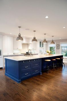 A Dream Home Renovation Complete with Oversized Kitchen Island – www.stylemepretty… A Dream Home Renovation Complete with Oversized Kitchen Island – www. Blue Kitchen Island, Blue Kitchen Cabinets, Kitchen Island With Seating, White Cabinets, Kitchen Counters, Design Kitchen Island, Kitchen Backsplash, Kitchen Island With Drawers, Kitchen Island Furniture