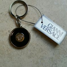 Versace Round Keychain Black and silver keychain with the beautiful Versace logo displayed in the center. Pic 2 shows a few minor scratches on the back. 3 1/4 inches including the ring. Gianni Versace Accessories Key & Card Holders