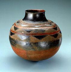 Africa | Jar from the Shona people of Zimbabwe | Ceramic, slip, resin | Mid 20th century |