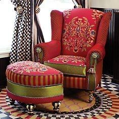 red arm chair and its rest food little sofa.