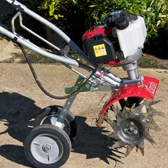 Wheel Set attaches to your Mantis Tiller in minutes. Lets you have the option to roll or carry your Tiller to your garden. Park your Mantis Tiller in an upr Small Garden Tiller, Small City Garden, Small Gardens, Small Garden Table And Chairs, Best Garden Tools, Gardening Tools, Agricultural Tools, Low Growing Shrubs, Lawn Care Tips