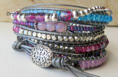 Wrap yourself in this stunning boho chic beaded leather wrap bracelet! A beaded bracelet of five wraps comprised of a main beaded wrap and an embellished wrap that is secured to the main beaded wrap resulting in a dramatic boho chic 10 wrap look. Handmade with the faith you will love your bracelet as much as I loved making it for you. Main Leather Wrap - 4mm Czech Fire Polished and 4mm Silver Plated Beads are secured between 1.5mm metallic grey leather.  Embellished Beaded Wrap - I use a…