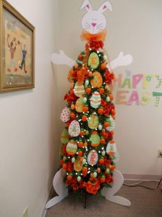 Make Easter decorations special with an Easter Egg tree. Learn how to use Twig tree or Christmas tree as an Easter tree.Check out Easter tree decor ideas. Easter Tree Decorations, Christmas Tree Themes, Holiday Tree, Xmas Tree, Easter Decor, Easter Ideas, Spring Decorations, Egg Tree, Hoppy Easter