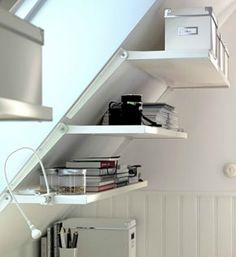 A slanted wall shelving unit for slanted walls at ikea: Ekby Riset adjustable brackets and shelves. Attic Renovation, Attic Remodel, Basement Renovations, Attic Storage, Storage Spaces, Camper Storage, Attic Spaces, Small Spaces, Office Spaces