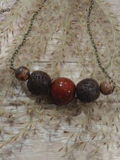 Lava and Clay Essential Oil Diffuser Necklace  https://www.etsy.com/listing/563445729/bead-bar-necklace-with-lava-stone-beads
