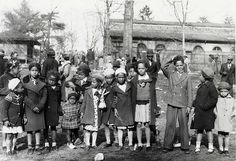 African American children in their Easter Monday best in front of the Lion House Addition at the National Zoo, Washington D.C., 1936. Smithsonian Institution Archives
