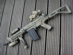 FN FAL SBR with ELCAN optic and IR laser, if you live in a 'free' state it's worth the BATFE tax to get one!