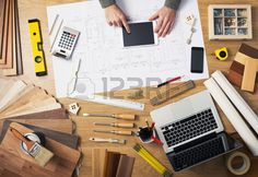 Construction engineer and architect s desk with house projects laptop tools and wood swatches top vi Stock Photo