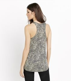 Tank you. A relaxed cut and a trendy front zip are what make this animal print top so effortlessly chic.