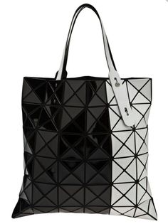 cb9b1d95f9ee Shop BAO BAO ISSEY MIYAKE Cut Out Tote from Farfetch Krikor Jabotian