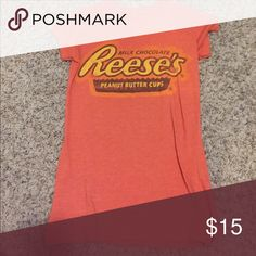 Reese's peanut butter cup shirt Orange Reese's peanut butter cup chief says size large but I think it's more of a small or medium perfect condition if you have any question feel free to ask Tops