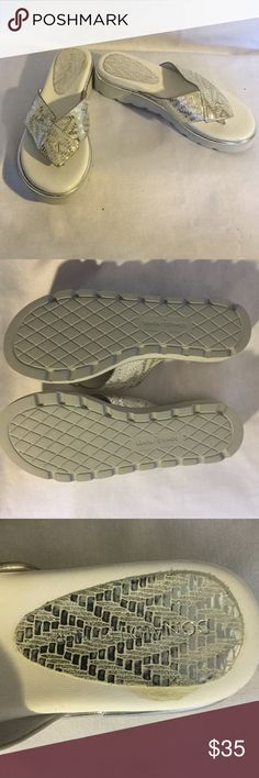 Silver metallic cushy sandals NWOT Leather uppers silver metallic pattern and silver edging around the entire shoe. Rubber bottom.  Pliner makes such comfortable shoes and these are so cute. Donald J. Pliner Shoes Sandals