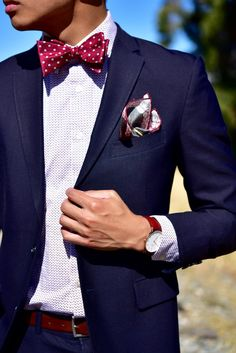 Dapper styling with a self tie bow tie.