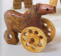 Toy horse   (5th–7th century)  Made of bone stained with red pigment, this wheeled horse from Egypt is one of the most luxurious toys to survive from its era, when bone was an expensive material.
