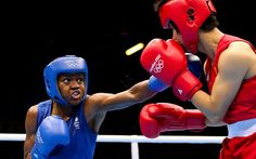 Nicola Adams against Cancan Ren of China during the Women's Fly (51kg) Boxing final bout on Day 13