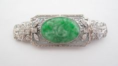 Beautiful antique jade and platinum pin with diamonds. This  pin was made in the 1940's.