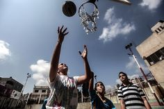 TO THE BASKET: Palestinian girls and their instructors practiced basketball Wednesday in Gaza City as part of an initiative to empower young girls. (Majdi Fathi/NurPhoto/Zuma Press)