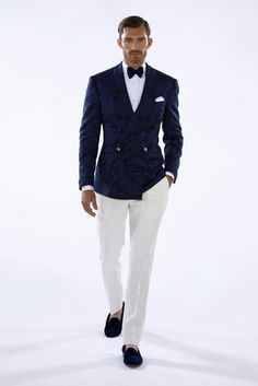 Eccentric bow tie style: paired with velvet double breasted jacket, white pants, and velvet slippers