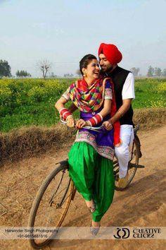 Cute couple - green and blue salwar kameez and phulkari chunni
