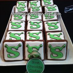 Sherk Themed Dessert Tables with cookies and cupcakes. www.sweetshindigs.com