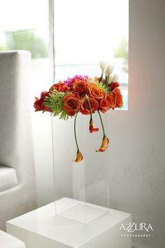 Orange Hanging Calla Centerpiece #orange  #floral arrangement