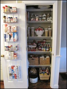 super organized pantry...could do over the door shelving for Chris' household stuff