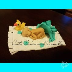 Fondant baby shower cake topper. #CatsCakesAndCandles