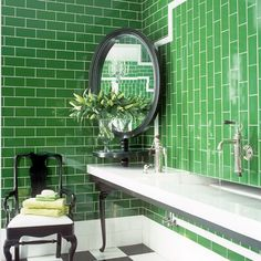 The traditional bottle-green shade of Victorian brick bathroom tiles is given a spin – literally and by pairing it with black-lacquered furniture.