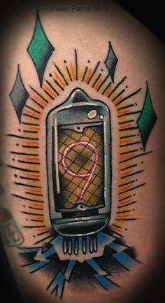 Do you like Nixie Tubes so much? ;-)  PS Tattooer is Shawn Patton