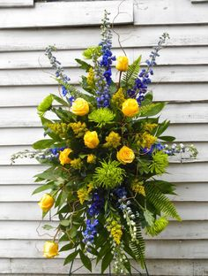 This funeral flower easel spray combines blue, yellow, and green toned flowers for a balanced farewell. Yellow Flower Arrangements, Funeral Floral Arrangements, Creative Flower Arrangements, Remembrance Flowers, Memorial Flowers, Church Flowers, Home Flowers, Flowers Garden, Potted Flowers