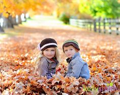 The pose is cute and I love the leaves but these kids are so darn cute!!