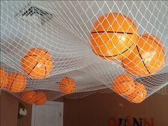 Basketball themed bedroom.....don't forget about the ceiling!  Wings interior decorating