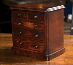 19th c English Miniature Mahogany Chest of Drawers | From a unique collection of antique and modern jewelry boxes at https://www.1stdibs.com/furniture/more-furniture-collectibles/jewelry-boxes/
