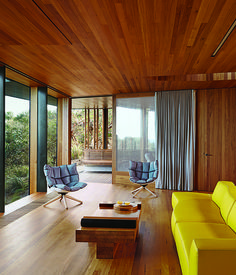 Refusing to fixate on the seascape at the expense of other views, Wardle oriented the living room to a lush grove of trees. A yellow Bend...