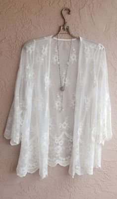 I have a lace cardigan like this and need black pants and sleeveless blouse in a solid color to wear as an outfit.