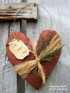 Wire-Hung Grungy Fabric Heart With Pinned Tag and Bound With Cheesecloth and a Sprig of Dried Flowers or Herbs Valentines Day Hearts, Valentine Day Crafts, Valentine Heart, Holiday Crafts, Primitive Crafts, Primitive Christmas, Fabric Hearts, Heart Crafts, Country Crafts