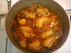"""This delicious dish of chicken stewed with vegetables is an indispensable part of Dominican cooking. Along with arroz con habichuelas (red beans and rice) and a side salad, pollo guisado makes up a patriotic lunch called la bandera, or """"the Dominican flag."""" Even so, Puerto Ricans are fans of pollo guisado too."""