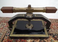 Circa a Victorian book press with gilded metal, and a wonderful cast brass hand mahogany turning arm. Superb piece of engineering and wonderful quality. Also included is mahogany and brass bound vice for holding the spines in. Victorian Books, Antique Books, Bookbinding Tools, Book Press, Iron Tools, Book Sculpture, Book Binding, Gravure, I Love Books