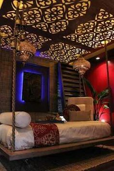 Moroccan Decor. I love the ceiling and moody feel.