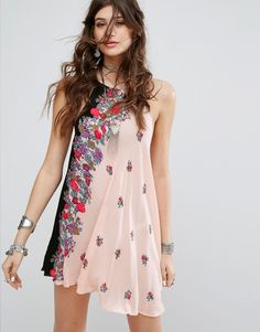 Buy it now. Free People Printed Slip Dress - Multi. Dress by Free People, Lightweight woven fabric, Floral print, Round neck, Tie detail, Asymmetric hem, Relaxed fit, Machine wash, 100% Rayon, Our model wears a UK XS/EU XS/US XS and is 174cm/5'8.5 tall. ABOUT FREE PEOPLE With roots back to the �70s, the Free People girl lives through art, fashion, music and wanderlust. She�s feminine in spirit and Bohemian in attitude. From sweet to tough, tomboy to romantic, Free People mishmash colour a...