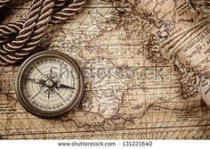 stock-photo-vintage-still-life-with-compass-and-old-map-131221640.jpg (450×320)