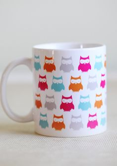"""Owl Groove Mug $14.99 at shopruche.com. Colorful little owls peer out from around this white ceramic mug, perfect for adding charm to your coffee or tea. Dishwasher and microwave safe.Ceramic, 3.75"""" x 3.25"""""""
