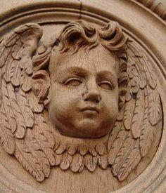 Bleached oak hand carved wooden angel in oak panel