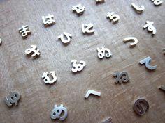 Japanese letter (hiragana) pierced earrings by Yuki Nagao, Japan