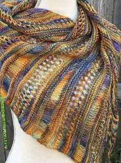 Free Knitting Pattern for One Skein Stormy Sky Shawl - Perfect for that one skein of special yarn! This asymmetrical shawl alternates sections of dropped stitches, eyelet lace, and garter stitch to showcase multi-colored yarn in skewed triangle. Easy to memorize. Designed by Life Is Cozy.Pictured project by River Poet who used one skein of Malabrigo yarn (420 yards) for the project.