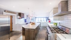 Fabulous modern kitchen oozing charm & perfect for entertaining at Pebble House, a luxury self-catering beach house in Cornwall #kitchen #entertaining #holiday #luxury #boutique #largekitchen #seaside