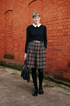 fashion your seatbelts. black cashmere jumper, white collar, plaid vintage shorts on black tights and docs.