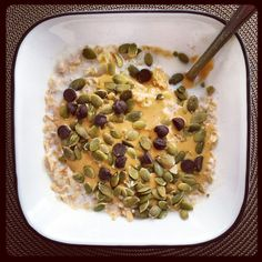 Chocolate-Peanut Butter Oatmeal With Pumpkin Seeds #breakfast #easy #quick https://greatist.com/eat/insanely-easy-blogger-breakfasts