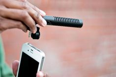 iPhone Boom Mic, plugs into your phone's headphone jack.  It includes a directional setting feature so that you can optimize recording based on how far away you are.  It won't be a drain on your iPhone's battery since it runs off of a single AAA battery.